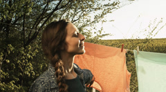 Pretty Woman Enjoying Purity Clean Smell Clothes Line in Nature Stock Footage