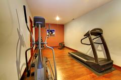 Modern home gym in the basement. Stock Photos
