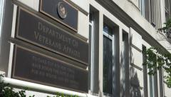 Sign, zoom out Department of Veteran Affairs, VA, headquarters building entrance - stock footage
