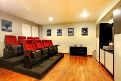 Home tv movie theater entertainment room interior. Stock Photos
