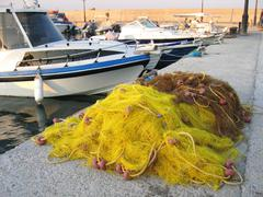 Fishing boats and net Stock Photos