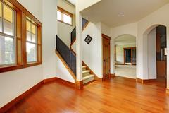 beautiful home entrance with wood floor. new luxury home interior. - stock photo