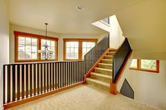 Staircase with metal railing. new luxury home interior. Stock Photos