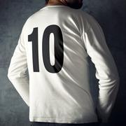 Man wearing sport shirt with number ten Stock Photos