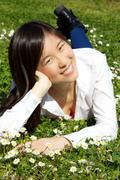 Happy cute asian woman relaxing in spring Stock Photos