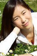 portrait of gorgeous chinese american woman in park - stock photo
