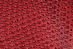 Red material into square, a background or texture - stock photo