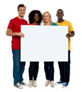 Team of young people holding whiteboard Stock Photos