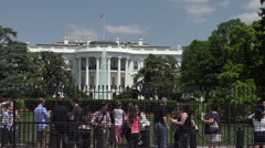 Tourists view White House south front behind fence Stock Footage