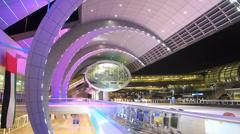 Colorful Time Lapse Dubai international Airport futuristic architecture neon Stock Footage