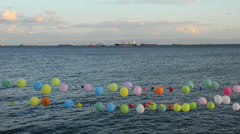 Erupted target colorful, balloons, near sea, target practice for fun in Istanbul Stock Footage