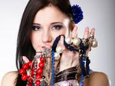 Stock Photo of summer girl plenty of jewellery beads in hands