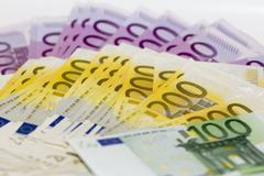 Isolated stack of money with 100 200 and 500 euro banknotes Stock Photos