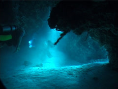 Group of scuba divers in swimthrough in Mexico, UP2933 Stock Footage