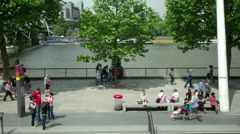 Time lapse of people walking by the Thames, Southbank. Stock Footage