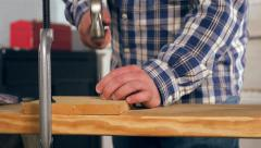 Carpenter Pounds Nail With Hammer in Workshop 1080P Stock Footage