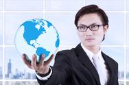 Stock Illustration of businessman hold globe in hand - indoor