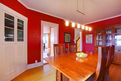 Classic red dining room with antique furniture Stock Photos