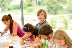High-school students at lesson in class teens - stock photo