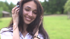 Young beautiful brunette girl listening to music on headphones Stock Footage