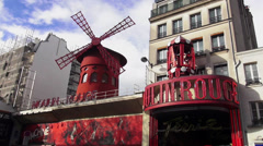 Famous Moulin Rouge in Red Light district of Paris Stock Footage