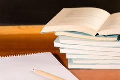 Academical study school books on wooden desk - stock photo