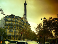 A view of the Eiffel Tower from one of the many streets of Paris Stock Footage