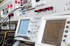 Digital and analog oscilloscope in the foreground Stock Photos
