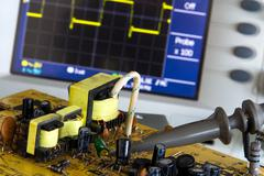 test pulse power and voltage waveform on the oscilloscope - stock photo
