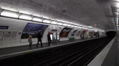 Metro arriving at subway station in Paris metropolitain Paris metro - stock footage