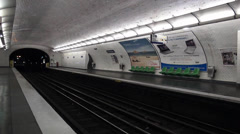 Train arriving at subway station in Paris metropolitain Paris metro - stock footage