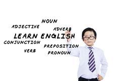 Schoolboy writes english language materials Stock Illustration