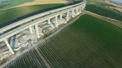 aerial view of train bridge and vineyard - stock footage