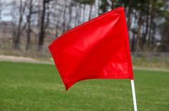 Red flag on soccer field Stock Photos
