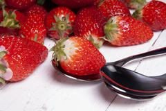 bio strawberries on a table. - stock photo