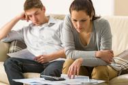 Stock Photo of Annoyed couple calculating their finances