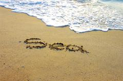 The Word Sea written in the Sand on a Beach - stock photo