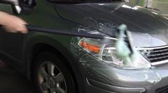 Man using foaming brush wash car Stock Footage