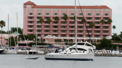 Sailboats docked in front of the historic Vinoy Hotel Stock Footage