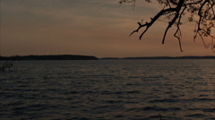Green Lake Sunset Geese Flying Overhead - Pan Stock Footage