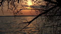 Green Lake Sunset with Geese Flying Overhead Stock Footage