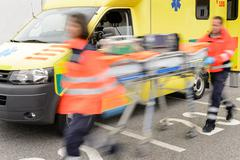 Running blurry paramedics team with stretcher - stock photo
