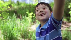 Little Boy Plays With A Butterfly Net In The Forest Stock Footage