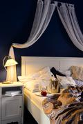 Empty unmade luxury bed romantic feeling champagne Stock Photos