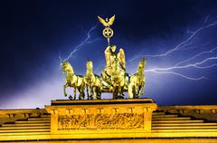Sky above Quadriga Monument, Brandenburg Gate in Berlin - stock photo