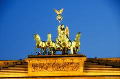 Majesty of Quadriga over Brandenburg Gate, with dramatic Sky - stock photo