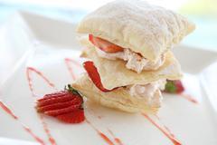 Strawberries and custard millefeuille desert Stock Photos
