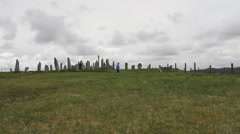 Timelapse of tourists and Callanish standing stones Stock Footage