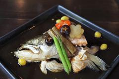 Japanese food bolied head fish with sauce Stock Photos