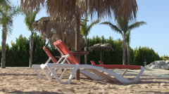 Sun lounger sand and palm trees Stock Footage